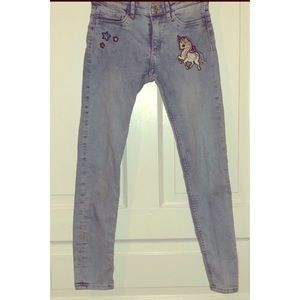 H&M girls skinny jeans with unicorn and stars